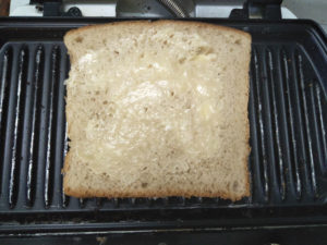 Butter toasting the sandwich