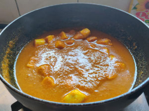 Adding water to Paneer Masala
